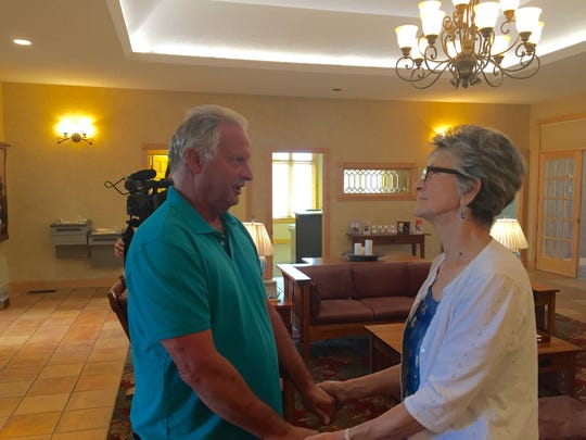 Brian Hensley thanks Mary Rose at the Aug. 30, 2016, memorial service for his sister, Sharon.
