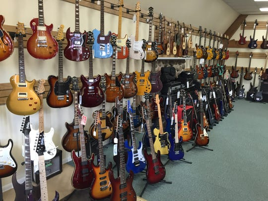 A selection of guitars at Northfield Music in Pittsford.