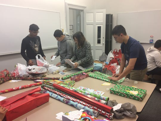 St. Lawrence Seminary sophomores wrap gifts as part of the Angel Tree program.