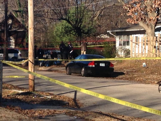 Police investigate the scene of a shooting on Powell Avenue near Holmes Street on Friday, Dec. 30, 2016.