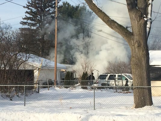 636188812488489762-Jan-1-2017-Wausau-garage-fire.jpg
