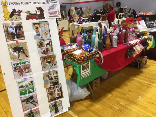 Sarah Trick and her family painted glasses and wine bottles, and displayed them along with a collection of donated handmade crafts from friends to offer as gifts in exchange for donations to the Broome County Dog Shelter.