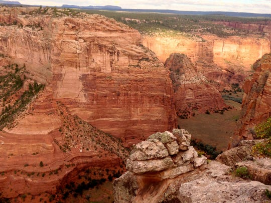 The sun sets over Canyon de Chelly located near Chinle.