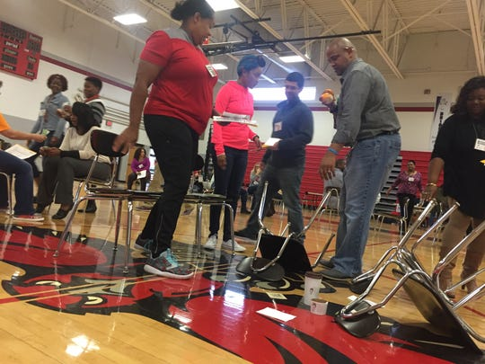 La Vergne Middle School faculty and staff participated in a poverty simulation Tuesday. This group was evicted from their home.