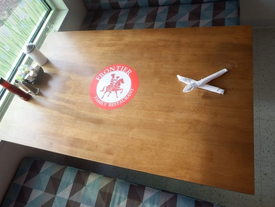 A table is shown at Frontier Family Restaurant at 1755