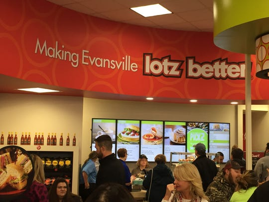 Customers check out Schlotzky's Deli, in the newly opened Crossroads IGA store at North Green River and Heckel roads.