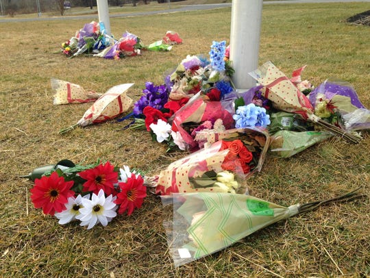 Flowers were laid at the flagpoles outside the Pennsylvania