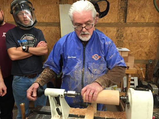 Retired businessman Mike Zinser of Green Hills teaches woodturning to young men at Narrow Gate Lodge in Williamsport, Tenn., twice a month. Zinser and friends from his woodturning club helped build the wood shop there.