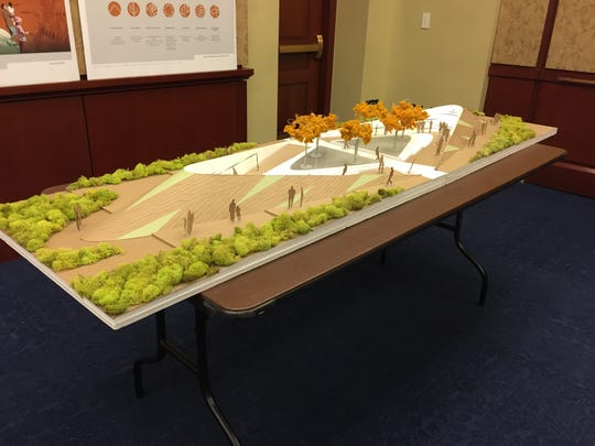 A model of the memorial is shown at Rep. Martha McSally's