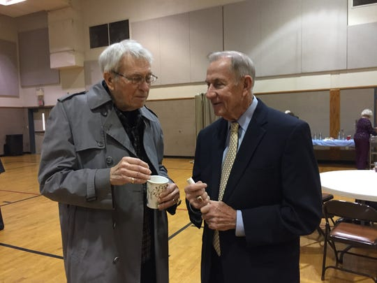Bob Griffin visits with A.L. Williams at the Orvis Sigler memorial service.