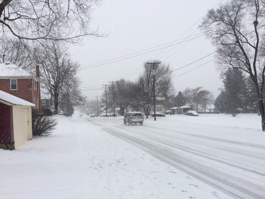 A driver braves the road conditions in Waynesboro,