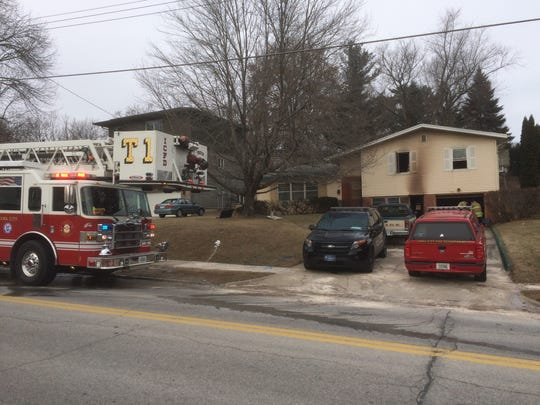 Iowa City police and fire personnel investigate a house fire at 1516 Rochester Ave. Sunday that killed one person.