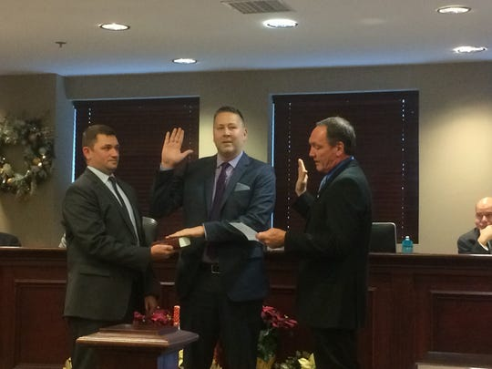Michael Warren, alongside his husband, was sworn in by Assemblyman Tim Eustace as a member of the Rochelle Park Township Committee at its annual reorganization meeting on Sat., Jan 7, 2017.