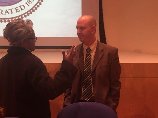 Alan Lewandowski talks with Port Huron Mayor Pro Tem Anita Ashford after his final City Council meeting on Monday, Jan. 9, 2017. He announced his resignation that night.