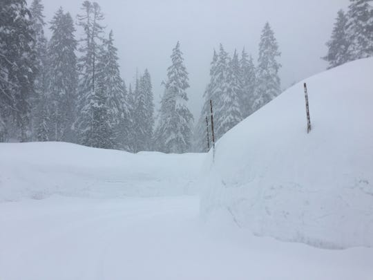 Snow banks on the road leading into Crater Lake National Park, which was closed by heavy snowfall.