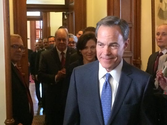 Texas House Speaker Joe Straus enters the chamber to