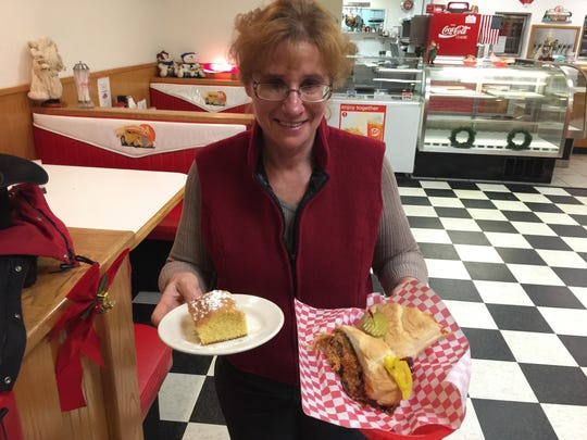 Owner Jeanine Tapal with order of cornbread and a shredded
