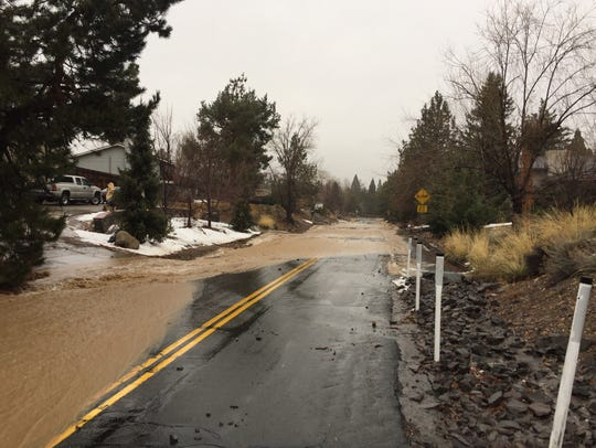 Water from the Steamboat Ditch floods Sagittarius Drive