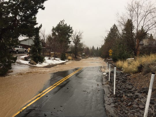 Water from the Steamboat Ditch floods Sagittarius Drive in Reno.