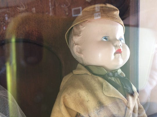 Raymond Berg gave this doll to his sister during World War II. It sits in a glass case in her dining room.