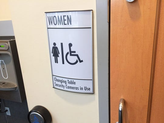 A sign outside the women's bathroom near the Iowa City