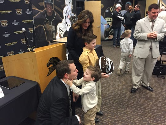 New WMU football coach Tim Lester shares a moment with
