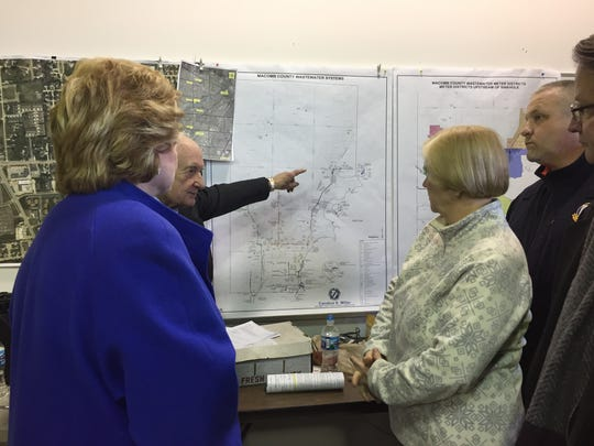 Michigan Congressional members, Macomb County commissioners and other state and local officials tour Jan. 15, 2017 the sewer interceptor collapse and sinkhole on 15 Mile in Fraser that was discovered Dec. 24, 2016 and condemned three houses.