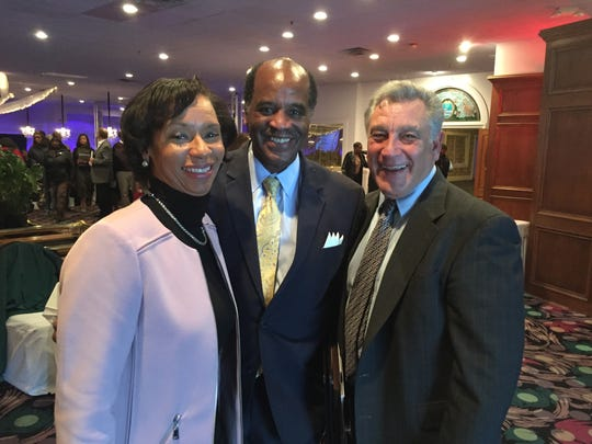NKY NAACP Martin Luther King Day luncheon keynote speaker Monica Posey and her husband, the Rev. Michael Posey, talk with Southbank Partners, Inc. President Jack Moreland inside The Newport Syndicate. Monica Posey is president of Cincinnati State Technical & Community College.