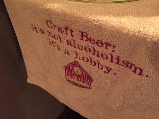 A bar towel bears a slogan at Red Barn Brewing in Danville.