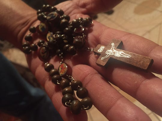 This rosary has been in  Geronimo Betancourt's family for more than 12 years. Betancourt, 47, has used it to pray for ill relatives. Now he is using it to pray for Donald Trump.