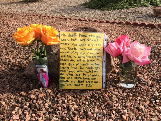 A memorial outside the Tempe house where Ryne Zahner, 26, was killed on Jan. 15, 2017.