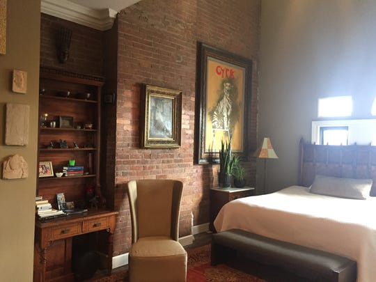 The loft unit features exposed brick walls.