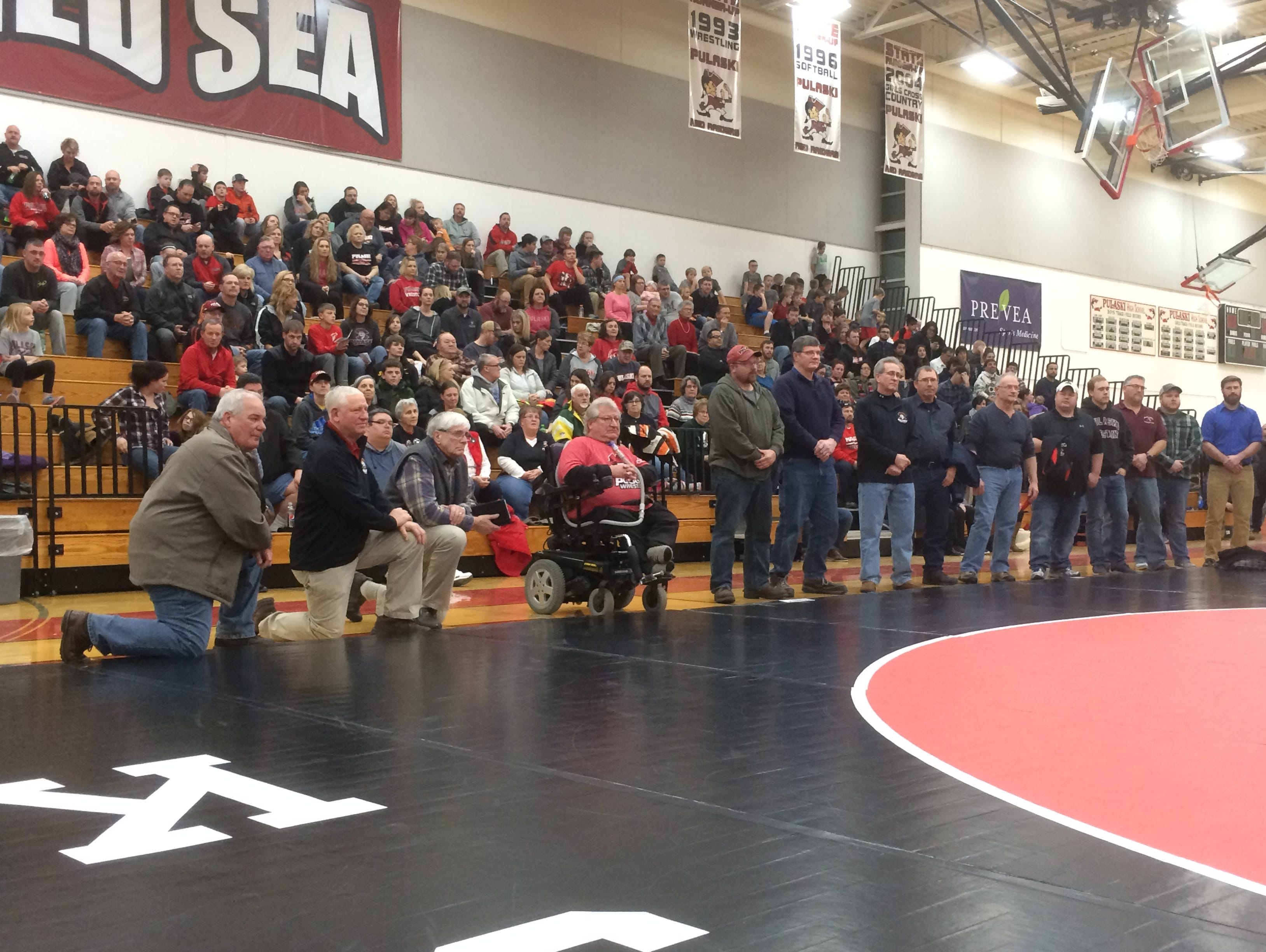 Gerald Lasecki, center, was informed he will be the recipient for the National Wrestling Hall of Fame's Medal of Courage last Thursday during Pulaski's alumni night.