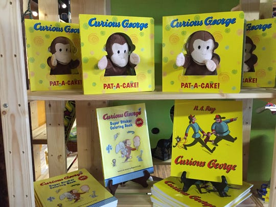 A selection of Curios George books on display at Impression 5 Science Center, Jan. 19, 2017.
