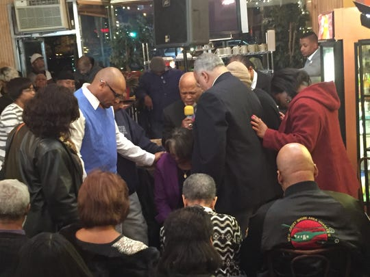 Clergy members praying over Rev. Tracey Brown on Thursday night as she announced her 2017 mayoral bid for Plainfield.