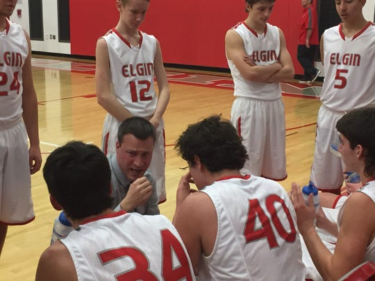 Elgin coach Bill Clem talks to his players during a timeout last season.