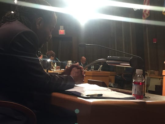 Wilmington Councilman Nnamdi Chukwuocha participates in a silent reflection, a new practice in place of the prayer during City Council meetings.