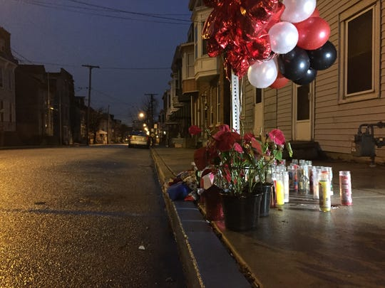 In this file photo, candles and flowers mark the spot on West Princess Street in York near where Ryan Small was fatally shot on Jan. 15, 2017.