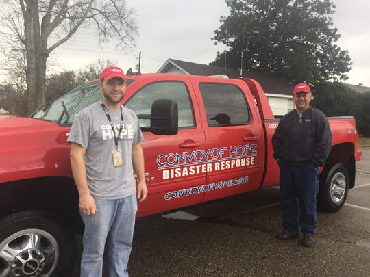 Convoy of Hope volunteers Ryan Grabill, left, and Ed Hultgren came to the Pine Belt from Springfield, Missouri, to help residents following an EF3 tornado that caused major damage Saturday.