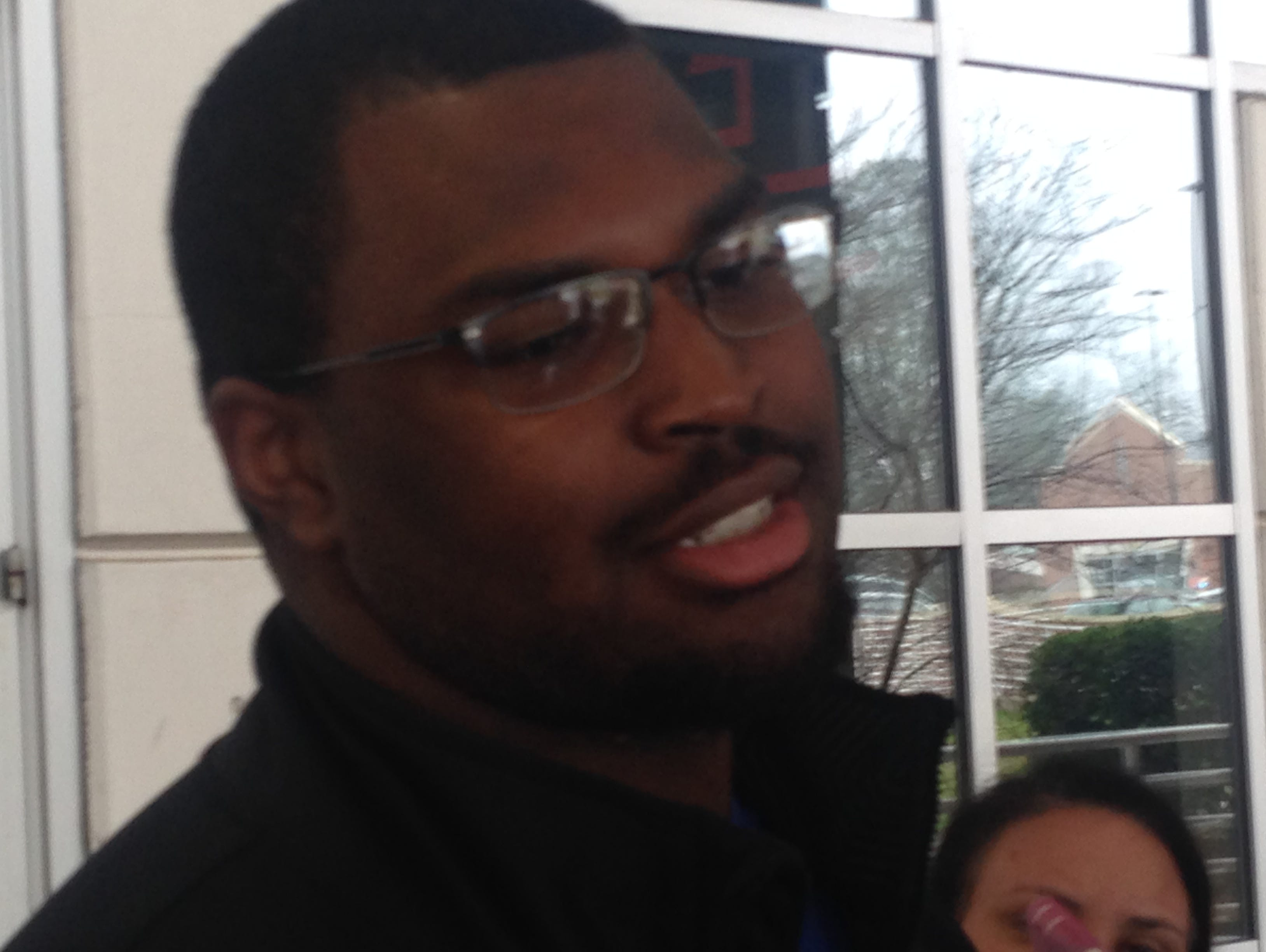 Auburn five-star offensive line commit Calvin Ashley talks to reporters following his official visit Sunday.