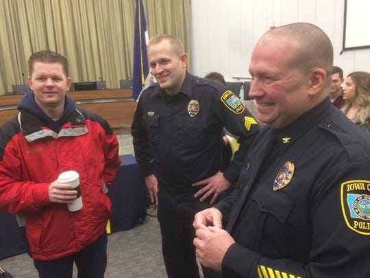 Jody Matherly, right, speaks with officers after being