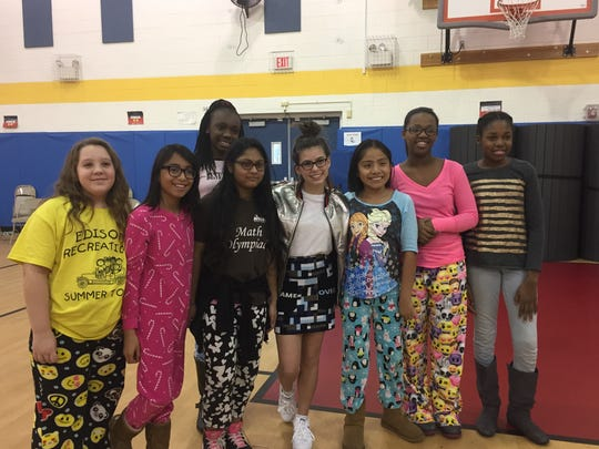 "Nickelodeon ""Game Shakers"" star Madisyn Shipman, with Principal Ami Hoffman's Girl's Group members, visited John Marshall Elementary School in Edison on Monday on behalf of the No Kids Hungry campaign."