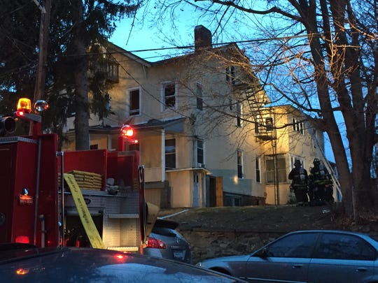 Firefighters on the scene of a fatal fire at 930 Diven