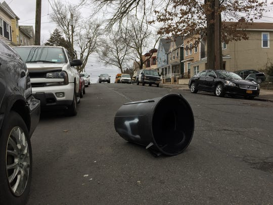 High winds Monday afternoon pushed this garbage can