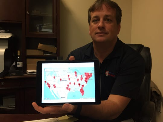 Jamie Hess, Truxx chief information officer, shows