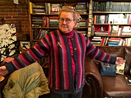 Maria Kuznia shows off a sweater she knitted for herself.