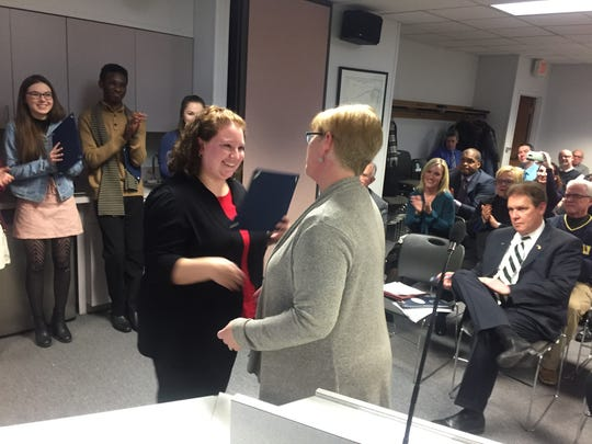 National Honor Society advisor Erin Le accepts the Mary Beth Carroll Extra Miler Award from school board Vice President Kate Borninski.