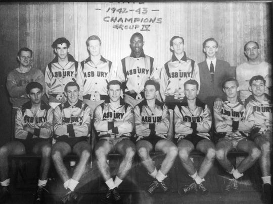 Asbury Park High School's state championship team from 1943, with Emil Baroska at the right end of the front row.