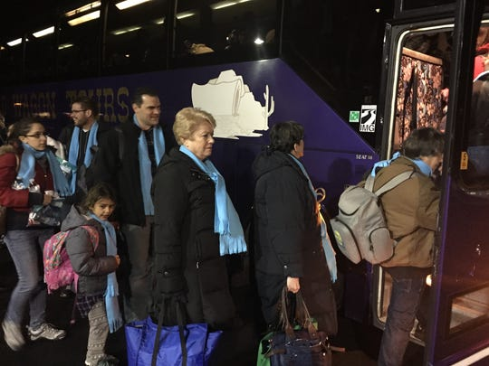 Fifty-five people board a bus at Our Mother of Sorrows Church in Greece on Thursday to head to Washington, D.C., for an anti-abortion march.