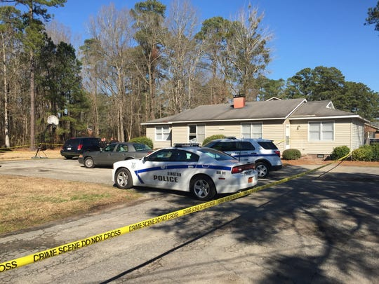 Kinston Police Department cars are parked outside a home Friday morning Jan. 27, 2017, in Kinston, N.C. Police in North Carolina say former North Carolina State basketball star Charles Shackleford, 50, has been found dead in his home Friday.